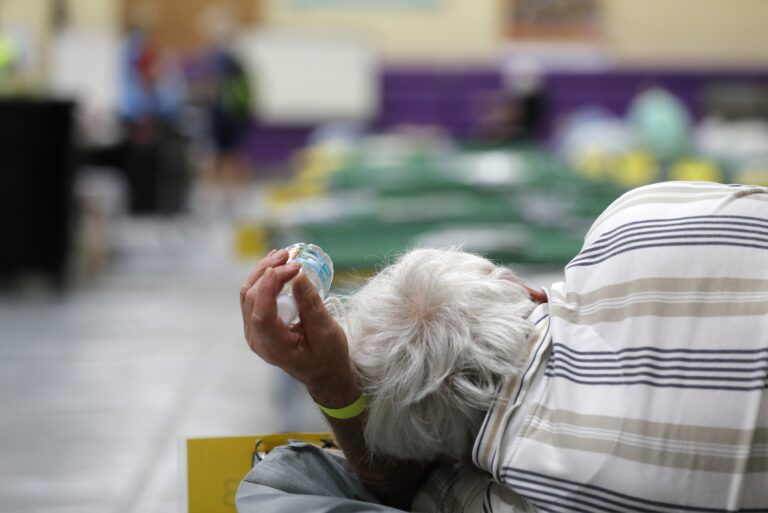 An evacuee lies on a cot at an evacuation shelter for people with disabilities in Stuart, Fla., in preparation for Hurricane Dorian on Sept. 1, 2019. Now, with the pandemic raging, officials across the South are trying to adjust their evacuation and shelter plans. (Gerald Herbert/AP Photo)