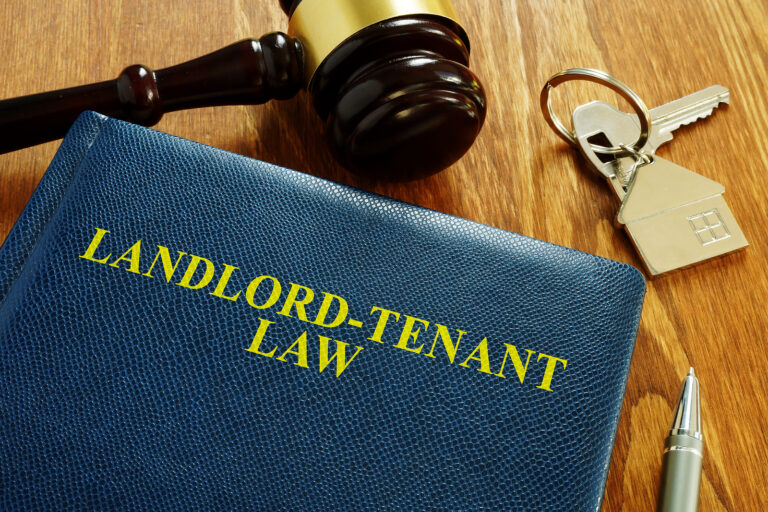 Landlord Tenant Law book and key from home. (Courtesy of BigStock)