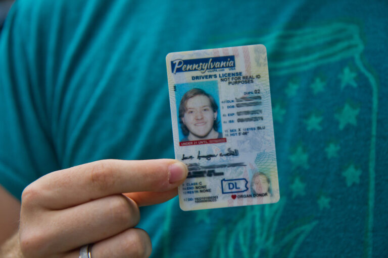 Finn Nahill holds a new drivers license, which uses the gender-neutral designation