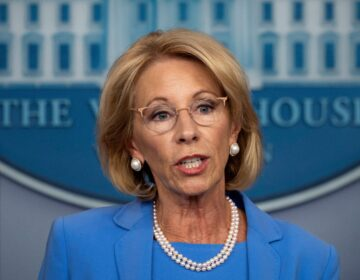 Education Secretary Betsy DeVos, seen here during a White House briefing in March, will participate in a panel discussion Tuesday on how to reopen America's schools safely. (Jim Watson/AFP via Getty Images)