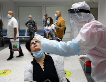 Passengers are tested for COVID-19 at Beirut International Airport on July 1. (Anwar Amro/AFP via Getty Images)