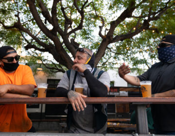 With new coronavirus infections climbing in most states, infectious disease experts are discouraging group get-togethers, especially those that involve drinking. In this photo patrons enjoy a beer outside the Central Market in Los Angeles, this week. (Francine Orr/Los Angeles Times via Getty Images)