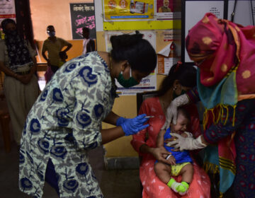Medical staff in Mumbai, India, last week. A U.N. report warns that the coronavirus pandemic is interfering with children getting vaccinated. (Anshuman Poyrekar/Hindustan Times via Getty Images)