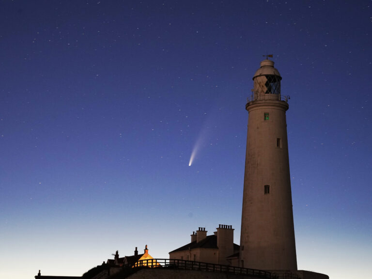 Comet Neowise passes St Mary's Lighthouse in Whitley Bay, UK in the early hours of Tuesday morning. (Owen Humphreys - PA Images/PA Images via Getty Images)