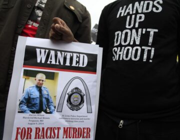 Demonstrators hold a sign in St. Louis, Mo., following the 2014 shooting death of 18-year-old Michael Brown. (Joshua Lott/AFP via Getty Images)
