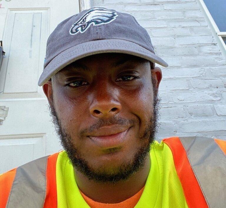 Terrill Haigler aka @_yafavtrashman smiles during a shift as a city sanitation worker. (Courtesy of Terrill Haigler)