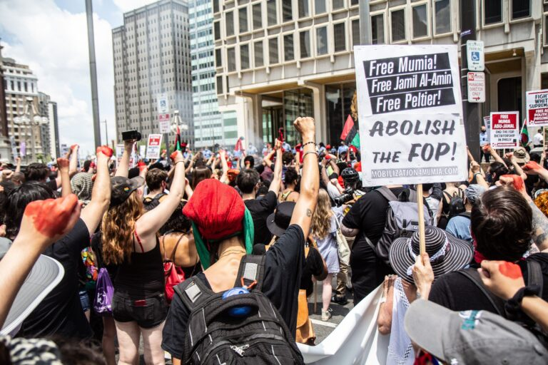 Protesters raised fists for nine minutes in front of Philadelphia's Municipal Service Building on the Fourth of July. (Kimberly Paynter/WHYY)