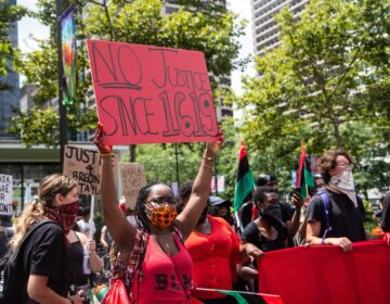 Protesters held a rally for reparations and racial justice on the Fourth of July outside Philadelphia's Municipal Services building. (Kimberly Paynter/WHYY)
