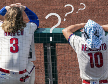 Philadelphia Phillies' Bryce Harper, left, and J.T. Realmuto, right look on from the dugout during the first inning of a baseball game against the Miami Marlins, Sunday, July 26, 2020, in Philadelphia. The Marlins won 11-6. (AP Photo/Chris Szagola)