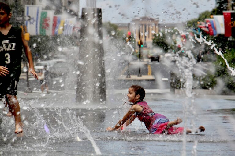 Kids cool off in the LOVE Park fountain