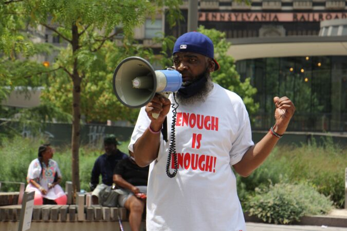 Activist Ikey Raw launches a rally against gun violence at Love Park. (Emma Lee/WHYY)