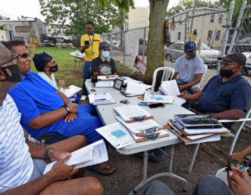 Residents meet in South Camden on August 6 to compile petitions they've circulated and plan strategy in an effort to return nonpartisan voting to the city. (Photo by April Saul for WHYY)