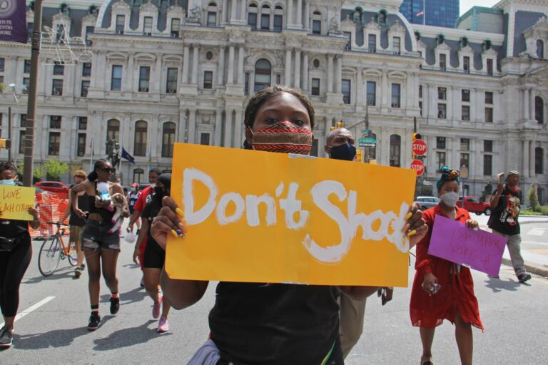 Sarai Ford marches with a group of young people calling for an end to gun violence on July 20, 2020. (Emma Lee/WHYY)