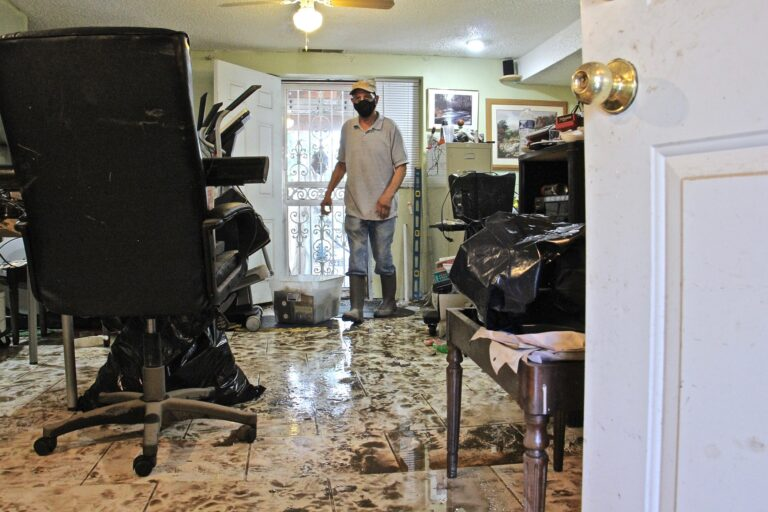 Flood water from Darby Creek rose to nearly four feet inside Leo Brundage's Eastwick home after Tropical Storm Isaias struck. (Emma Lee/WHYY)