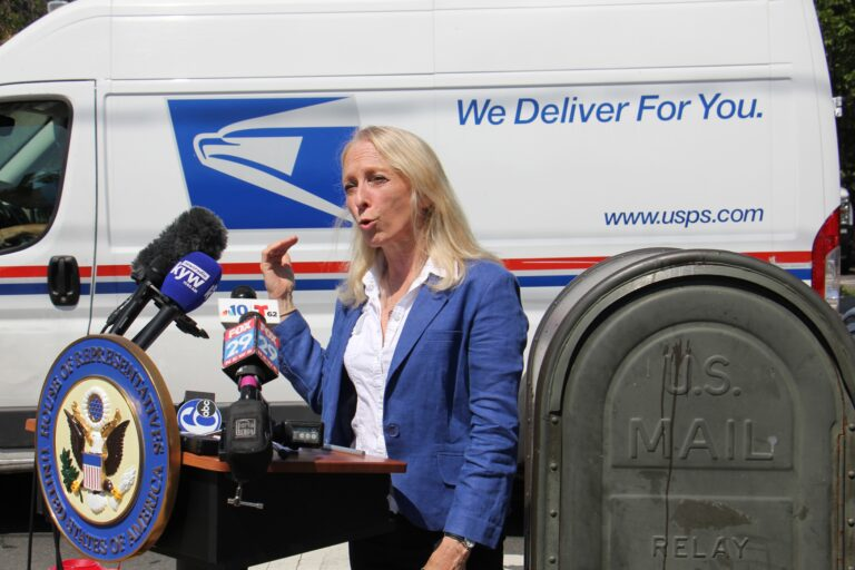 U.S. Rep. Mary Gay Scanlon joins federal, state and local officials at Second and Spring Garden streets to call for emergency funding for the struggling U.S. Postal Service. (Emma Lee/WHYY)