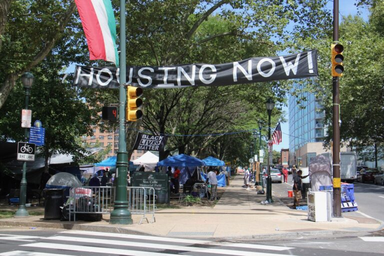 A homeless protest encampment occupies Von Colln Field on the Ben Franklin Parkway