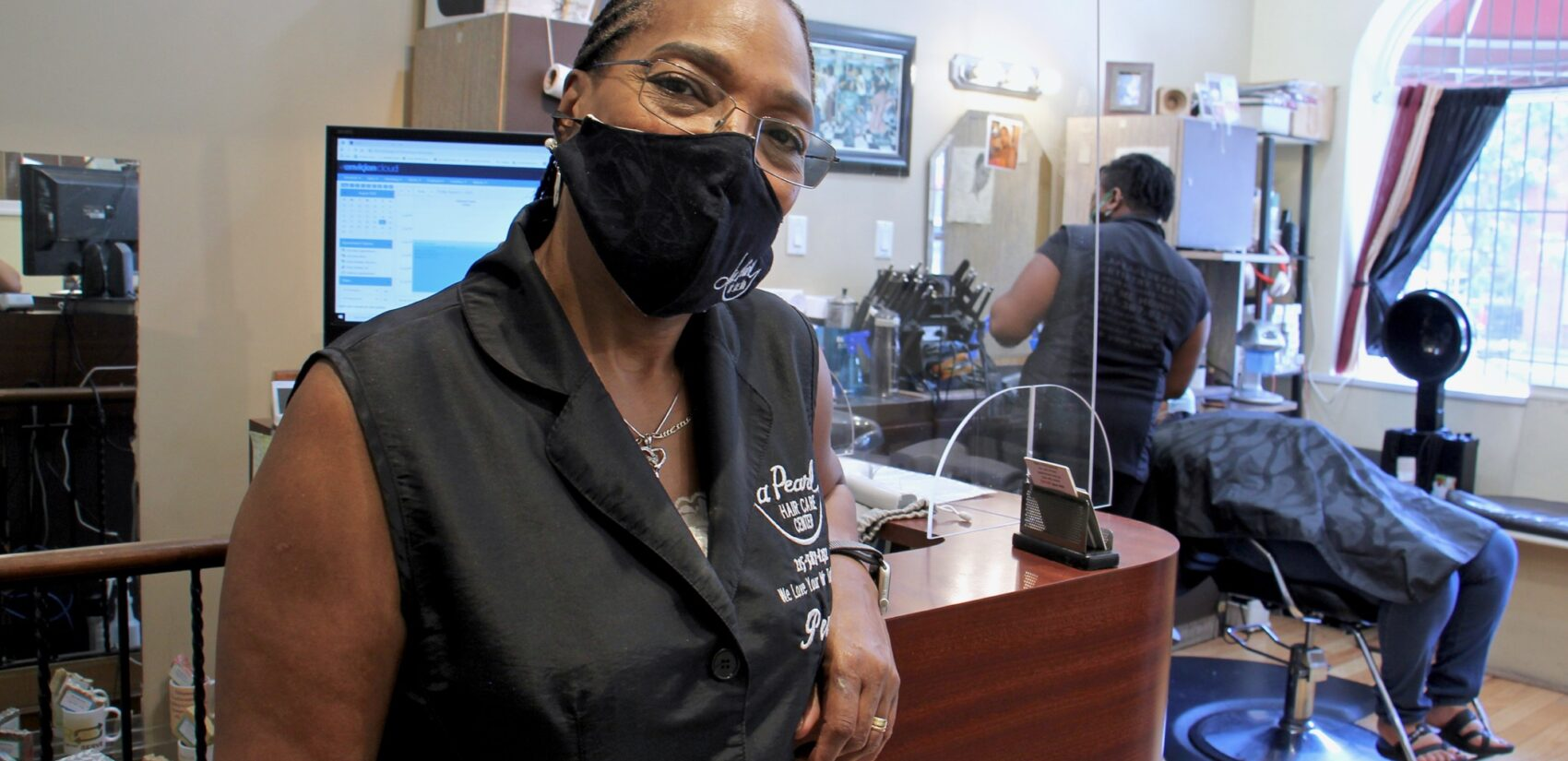 Pearl Bailey-Anderson owns La Pearl Beauty Emporium on Lancaster Avenue. (Emma Lee/WHYY)