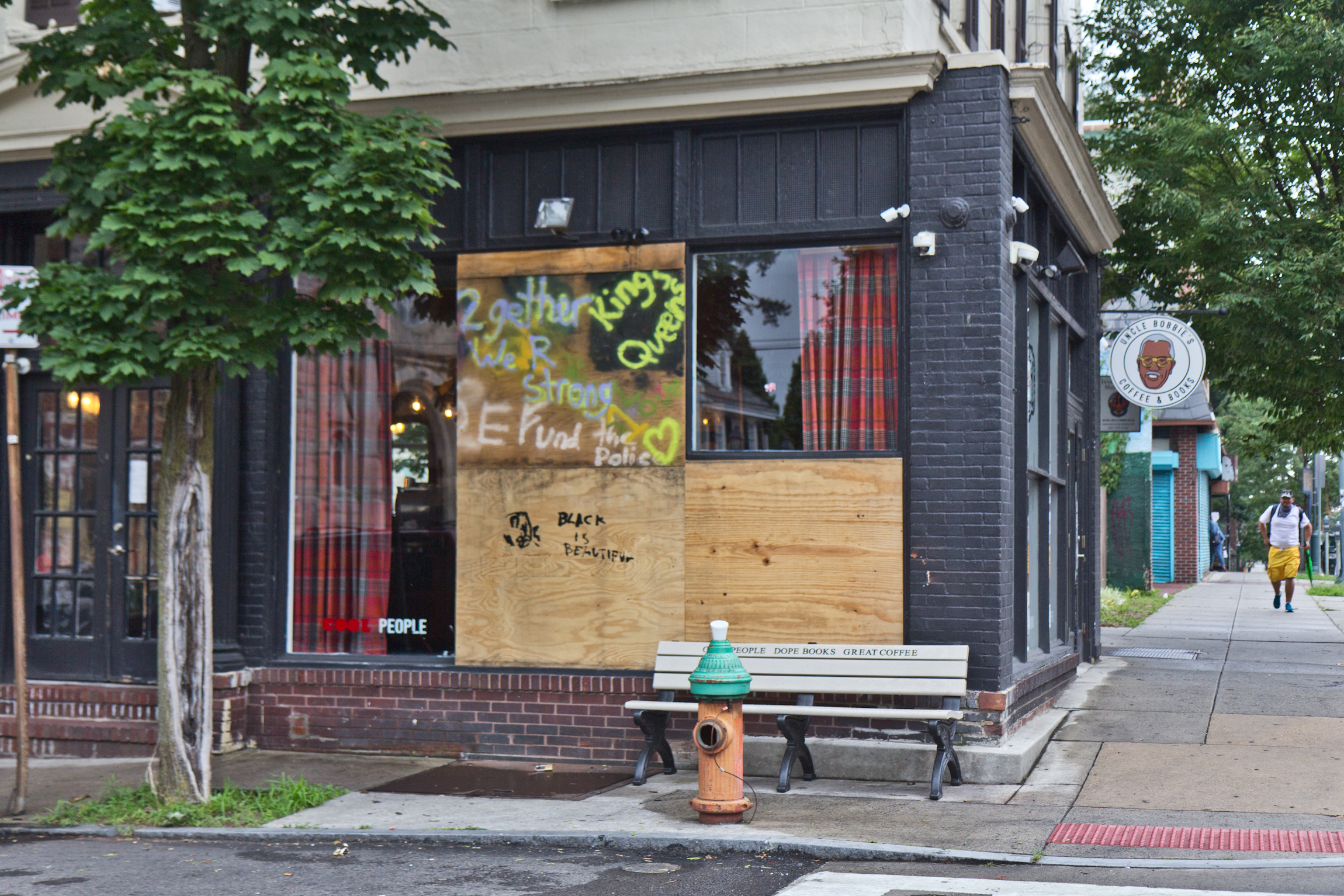 Boarded up windows at Uncle Bobbie's Coffee and Books in Germantown