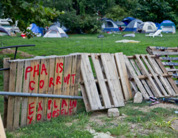 A homeless encampment at 21st and Ridge Avenue adjacent to PHA headquarters in North Philadelphia. (Kimberly Paynter/WHYY)