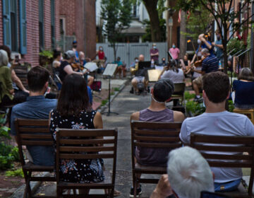 Philadelphia musicians playing music on a narrow rowhouse block
