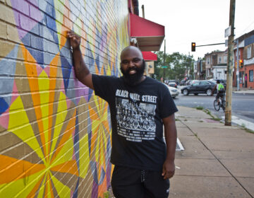 Omar Tate is a Philadelphia artist and chef. He is working to raise money to open the Honeysuckle Community Food Center in West Philadelphia. (Kimberly Paynter/WHYY)
