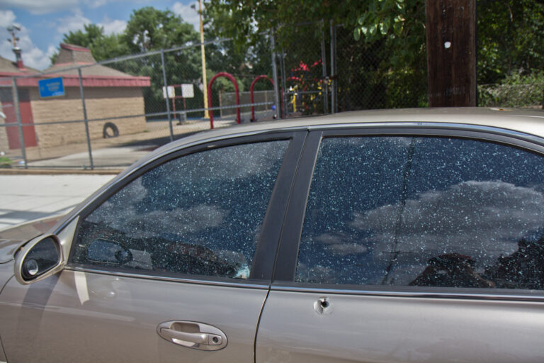 A bullet hole in a vehicle outside Clayborn and Lewis Playground in West Philadelphia. (Kimberly Paynter/WHYY)