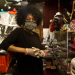 In this August 2020 photo, Gwendolyn Hosey, the owner of Struttin' Lightly, is in her accessory store on 52nd Street in West Philadelphia. (Kimberly Paynter/WHYY)