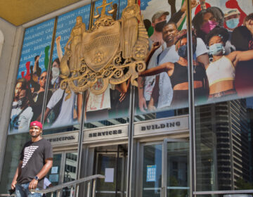Mural artist Russell Craig included his own image in the crown-shaped collage of protesters now on Philadelphia's Municipal Services building, behind where the statue of controversial Mayor Frank Rizzo stood until June. (Kimberly Paynter/WHYY)