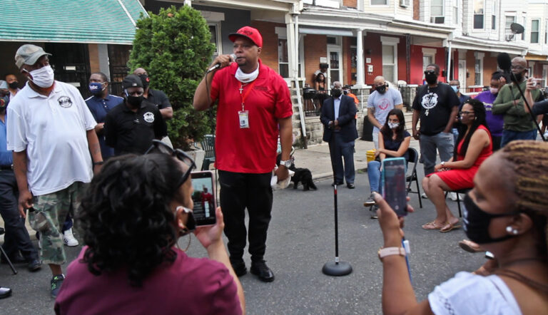 Colwin Williams with Cure Violence tells Simpson Street residents that officials are putting a Band-aid on the problem and not dealing with real issues surrounding gun violence. (Kimberly Paynter/WHYY)