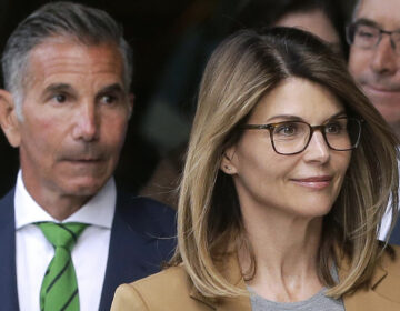 In this April 3, 2019 file photo, actress Lori Loughlin, front, and husband, clothing designer Mossimo Giannulli, left, depart federal court in Boston after facing charges in a nationwide college admissions bribery scandal. (AP Photo/Steven Senne)