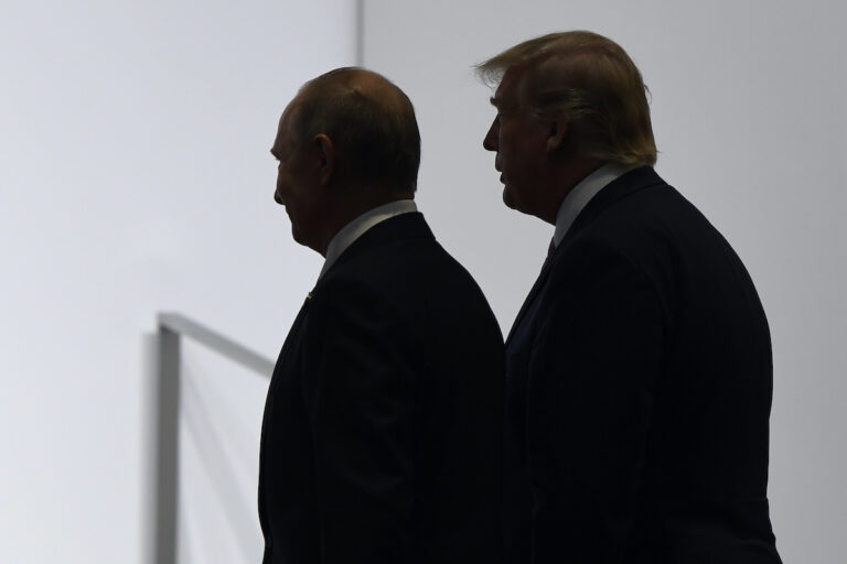 FILE - In this June 28, 2019, file photo, President Donald Trump and Russian President Vladimir Putin walk to participate in a group photo at the G20 summit in Osaka, Japan.  (AP Photo/Susan Walsh, File)