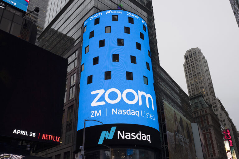 FILE - In this April 18, 2019, file photo shows a sign for Zoom Video Communications ahead Nasdaq IPO in New York.  (AP Photo/Mark Lennihan, File)