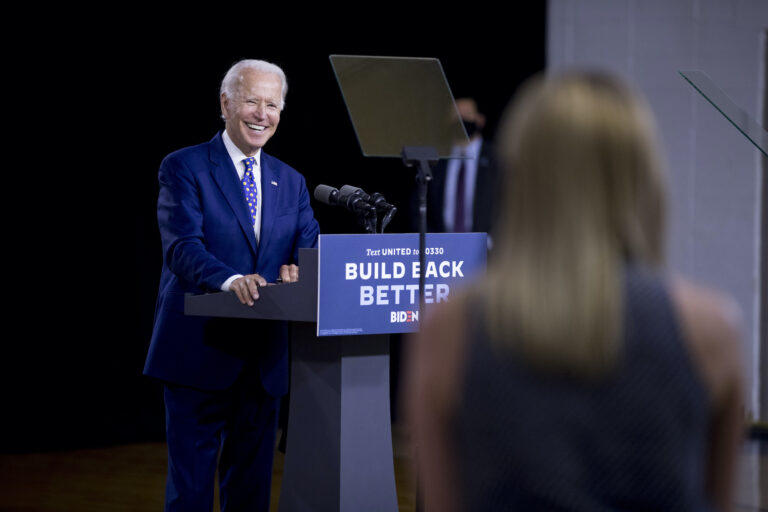 Democratic presidential candidate former Vice President Joe Biden smiles as he takes a question from a reporter at a campaign event at the William