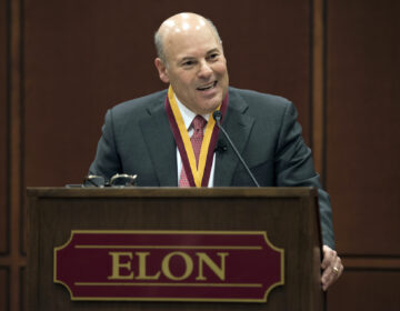 In this March 1, 2017, file photo, Elon Trustee Louis DeJoy is honored with Elon's Medal for Entrepreneurial Leadership in Elon. N.C. (Kim Walker/Elon University via AP)