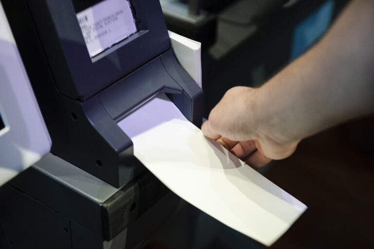 In this June 13, 2019 file photo, an Investigator with the Office of the City Commissioners, demonstrates the ExpressVote XL voting machine at the Reading Terminal Market in Philadelphia. (AP Photo/Matt Rourke)