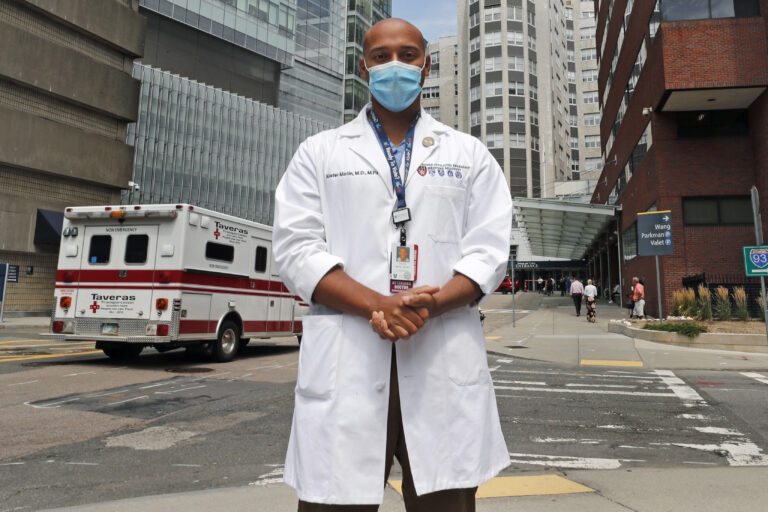 Alister Martin, an emergency room doctor at Massachusetts General Hospital, poses outside the hospital, Friday, Aug. 7, 2020, in Boston. Martin founded the organization