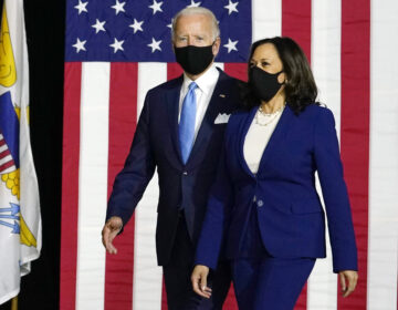 Democratic presidential candidate former Vice President Joe Biden and his running mate Sen. Kamala Harris, D-Calif., arrive to speak at a news conference at Alexis Dupont High School in Wilmington, Del., Wednesday, Aug. 12, 2020. (AP Photo/Carolyn Kaster)
