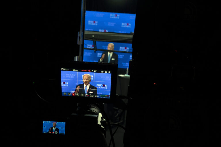 In this Aug. 12, 2020, file photo Democratic presidential candidate former Vice President Joe Biden is seen on monitors as he speaks during a virtual grassroots fundraiser at the Hotel DuPont in Wilmington, Del. As Democrats gather virtually this week to nominate Joe Biden for the presidency, party leaders and activists across the political spectrum agree on one unifying force: their desire to defeat President Donald Trump. (AP Photo/Carolyn Kaster, File)