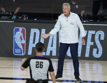 Philadelphia 76ers head coach Brett Brown looks to an official during the first half of an NBA basketball first round playoff game against the Boston Celtics Monday, Aug. 17, 2020, in Lake Buena Vista, Fla. (AP Photo/Ashley Landis, Pool)