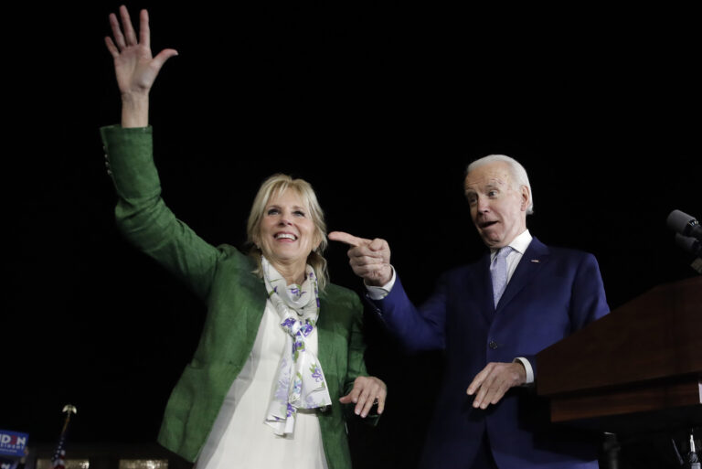 In this Mar. 3, 2020, file photo, Democratic presidential candidate former Vice President Joe Biden, right, and his wife Jill attend a primary election night rally in Los Angeles. (AP Photo/Marcio Jose Sanchez)