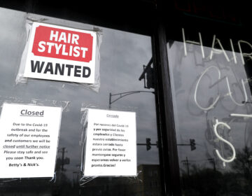 In this April 30 ,2020 file photo, a barber shop shows closed and hiring sign during the COVID-19 in Chicago.  On Thursday, Aug. 27, just over 1 million Americans applied for unemployment benefits last week, a sign that the coronavirus outbreak continues to threaten jobs even as the housing market, auto sales and other segments of the economy rebound from a springtime collapse. (AP Photo/Nam Y. Huh, File)