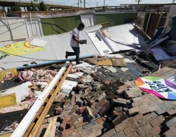 Benjamin Luna helps recover items from the children's wing of the First Pentecostal Church that was destroyed by Hurricane Laura, Thursday, Aug. 27, 2020, in Orange, Texas. (AP Photo/Eric Gay)