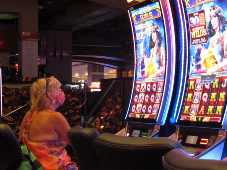A woman plays a slot machine at the Golden Nugget casino in Atlantic City
