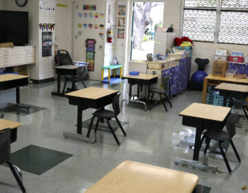 Desks are spaced out in a classroom