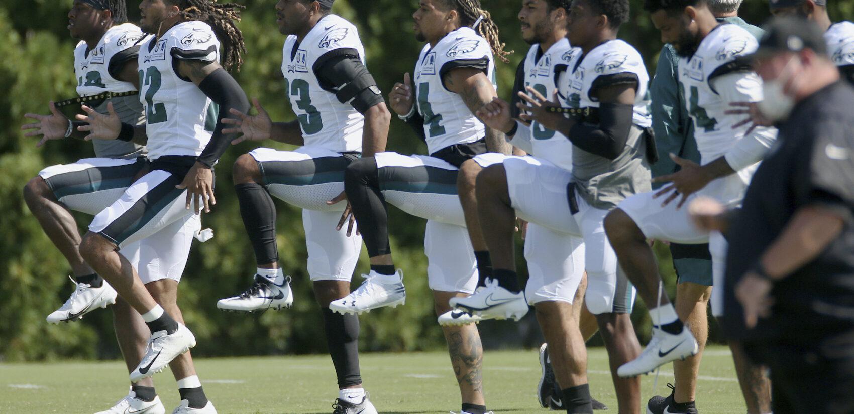 Philadelphia Eagles defenders warm up during NFL training camp