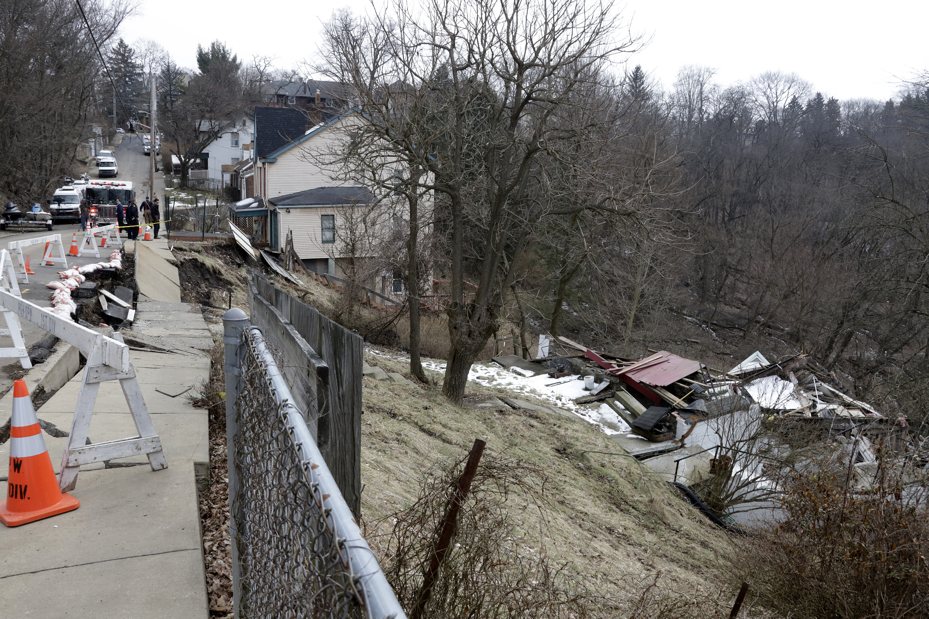 Pittsburgh Public Safety workers inspect a house that collapsed due to a landslide