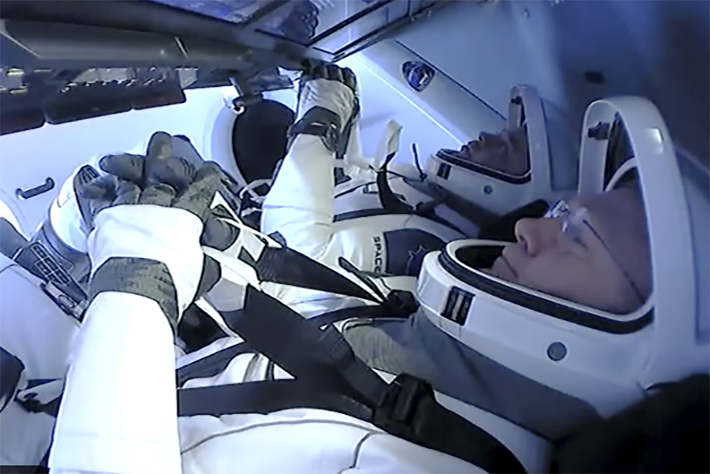 Astronauts Doug Hurley and Bob Behnken prepare to return to earth on a SpaceX capsule