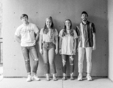 A black and white photo of the band Benson, comprised of siblings Brianna, Hudson, Schyler and Haley Marsh