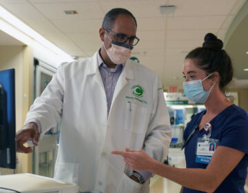 Dr. Mike Benninghoff confers with registered nurse Lea Robbins in Christiana Hospital's intensive care unit for COVID-19 patients. (Courtesy of ChristianaCare)