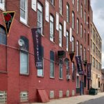 Heather Raquel Phillips' flags, celebrating the 100 year anniversary of Marcus Garvey's Pan-African flag, hang outside the Practice Gallery at 319 11th St. in Philadelphia. (Courtesy of Heather Raquel Phillips)